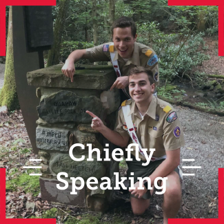 "The National Chief Zach Schonfeld and National Vice Chief Noah Smith pointing to a rock with ""Quapaw Little Rock, AR"". The overlying text says chiefly speaking."