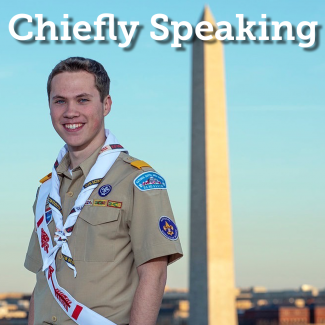 The National Chief Zach Schonfeld standing next to the washington monument.